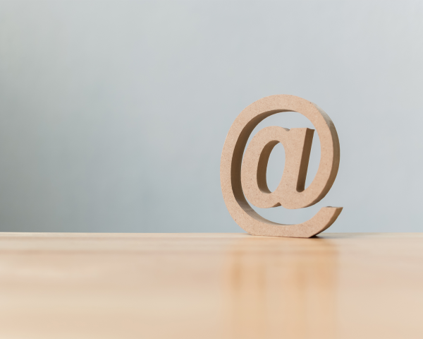 Email address icon wooden symbol Contact us customer service by email concept on Digital Marketing Solutions page