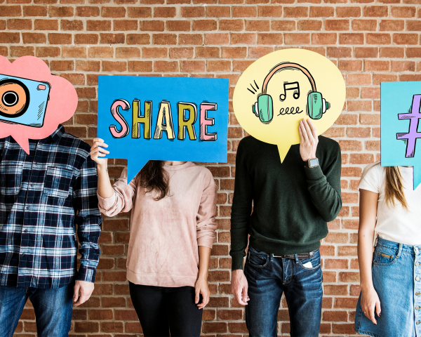 Friends holding up thought bubbles with social media concept icons Slider