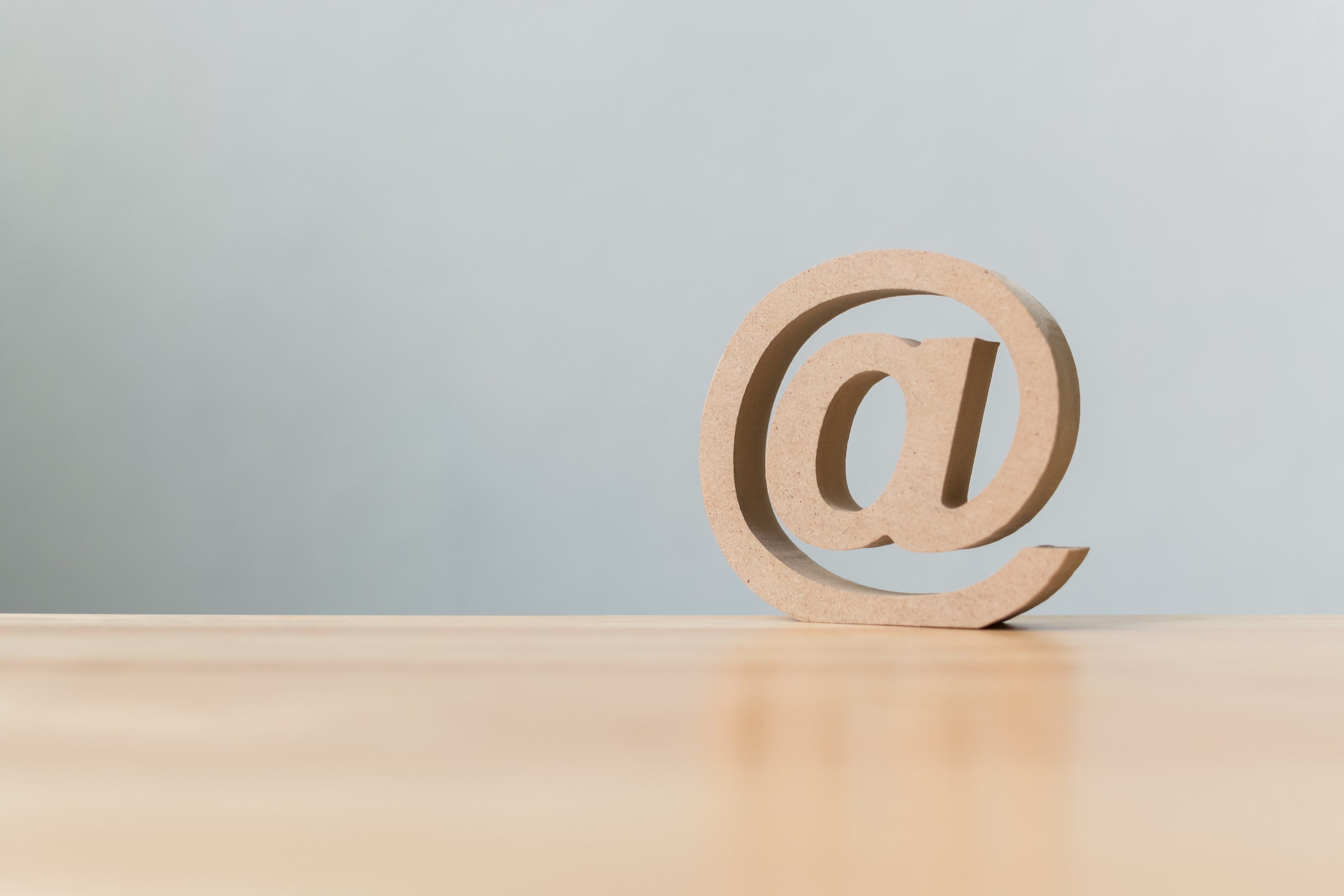 Email address icon wooden symbol Contact us customer service by email concept